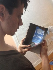 Josh looks at one of the first copies of 'A Sliver of Light' in awe.